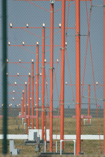 runway lights in daylight - steven harrie stock photos and pictures