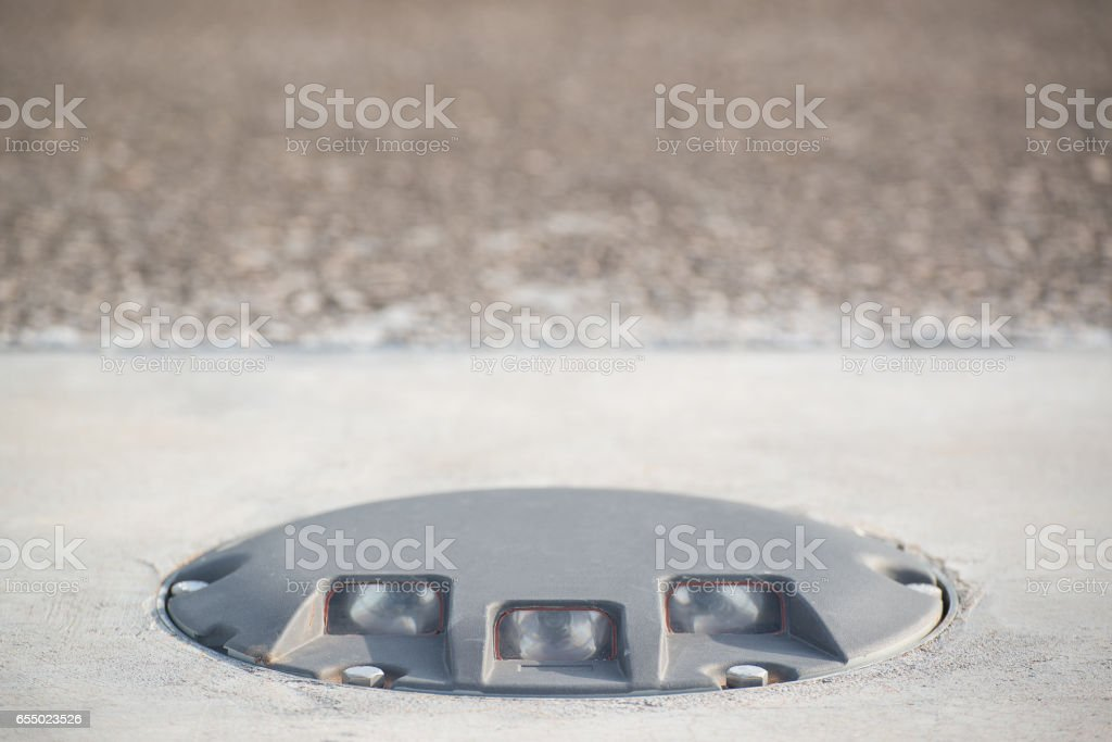 Runway threshold light on the concrete pavement stock photo