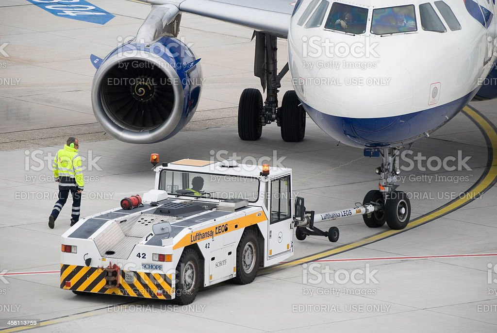 Runway tractor pushing passenger aircraft at Duesseldorf Airport stock photo