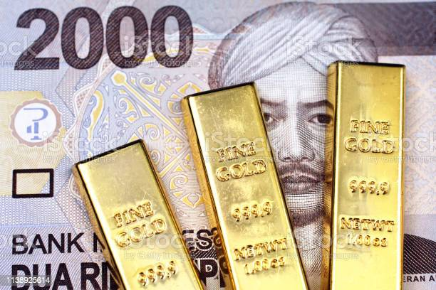 A 2000 rupiah Indonesian bank note with three gold bars