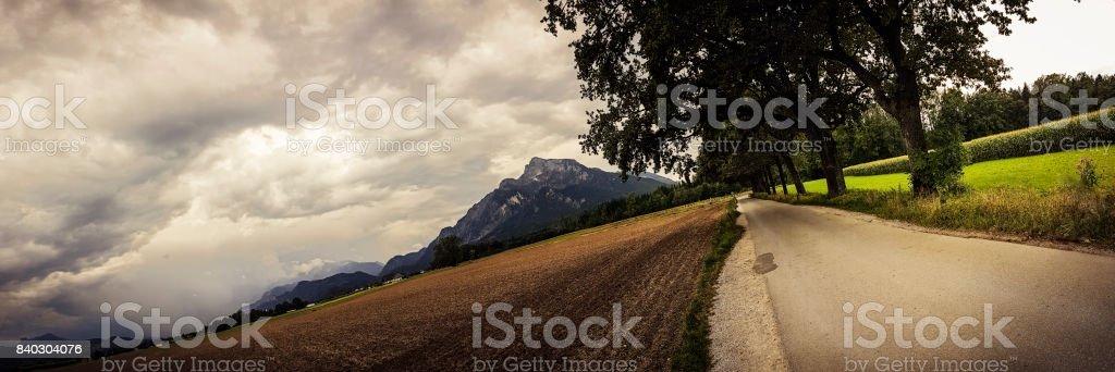 Rural Alpine Panorama under Dramatic Sky stock photo