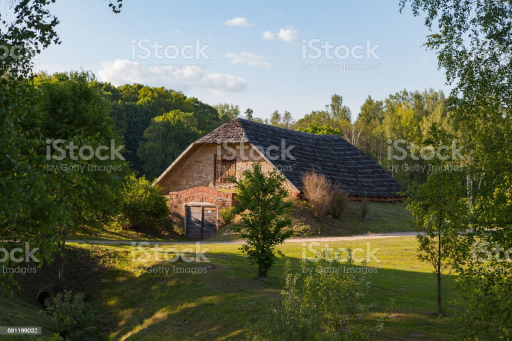 Rural brick house on the meadow. Latvian countyside stock photo