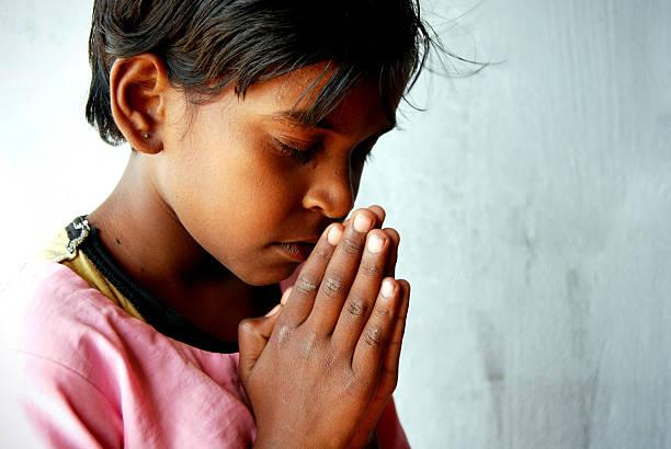 Rural child praying stock photo