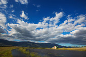 Rural cloudscape with cottage and mountains, brief code 700031830,  Swellendam, Western Cape, South Africa
