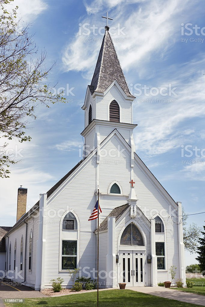 Rural Country Church of Wooden Clapboard and Steeple, with Flag stock photo