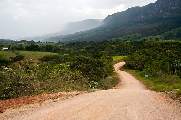 Rural dirt road with mountain on background stock photo