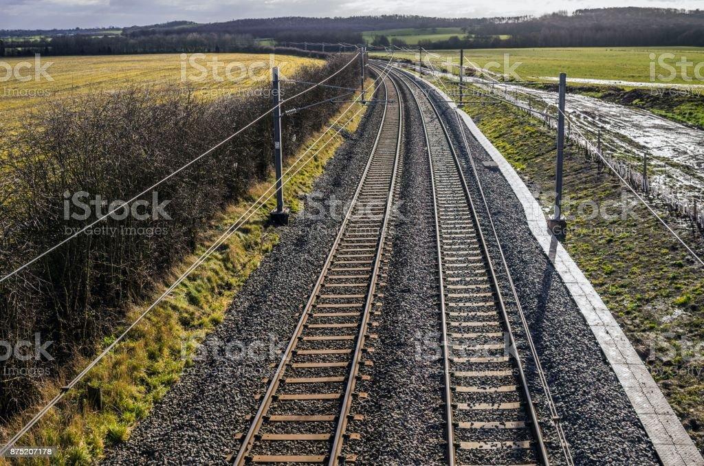 Rural electrified railway line stock photo