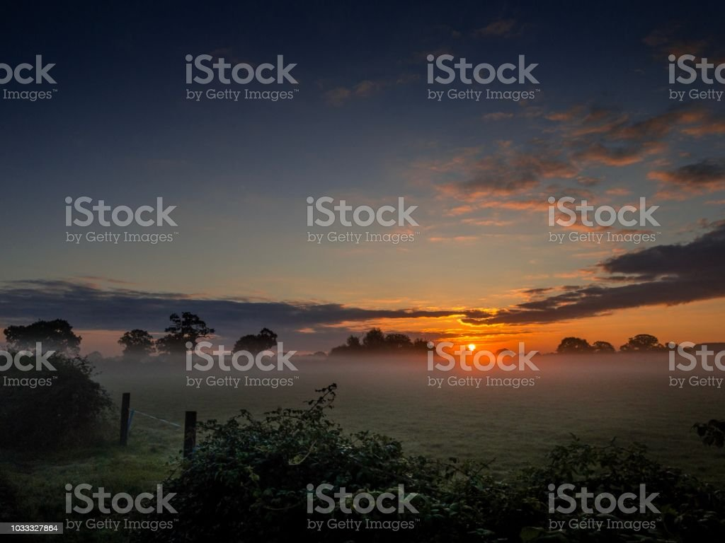 Rural farm view sunrise and fog Cheshire stock photo