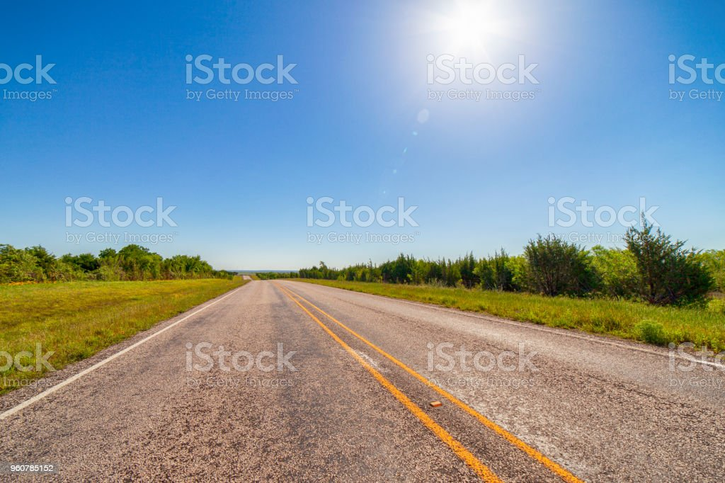 Rural highway with sunshine stock photo