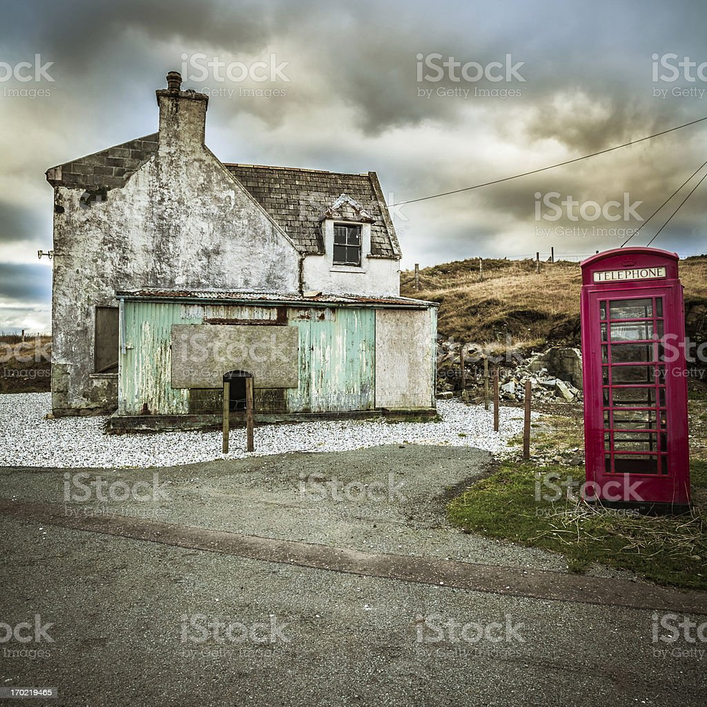 Rural House and Red English Telephone Booth in Scotland stock photo
