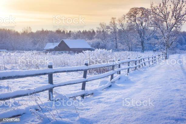 Photo of Rural house with a fence in winter