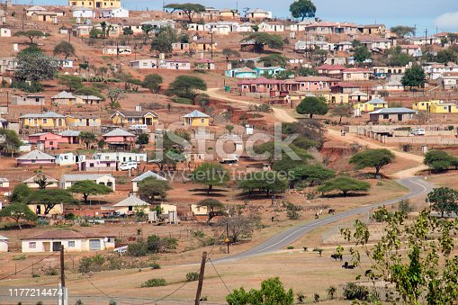 Housing and huts scattered informally over hilly area in rural south africa