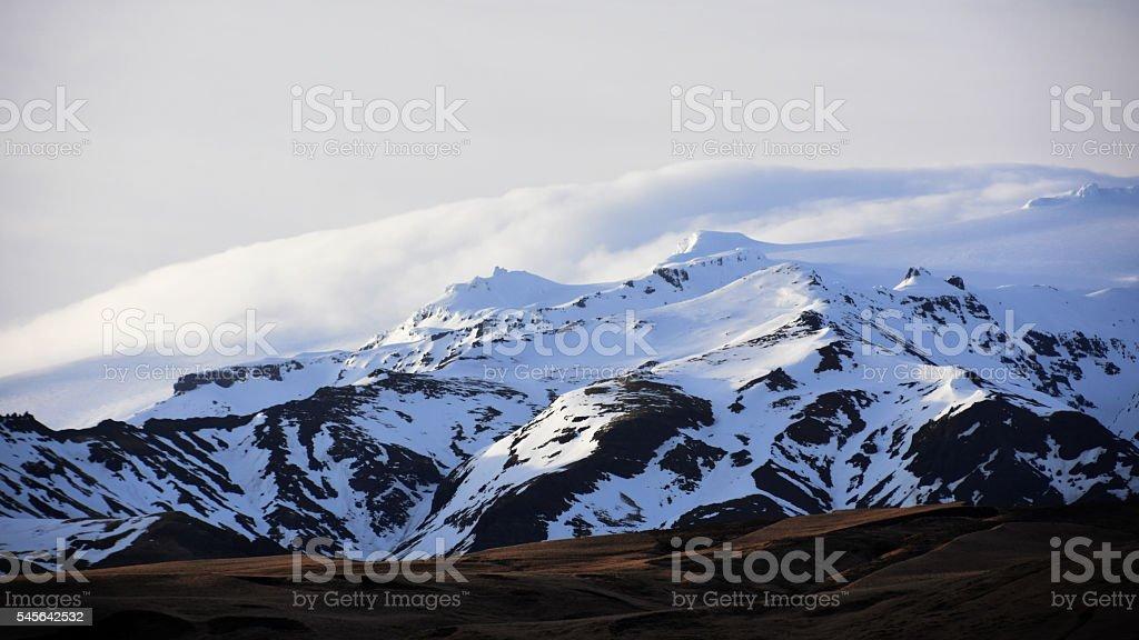Rural Iceland -Eyjafjallajokull volcano with a shroud of mist stock photo