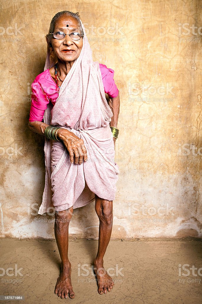 Rural Indian Senior woman standing in a Village royalty-free stock photo