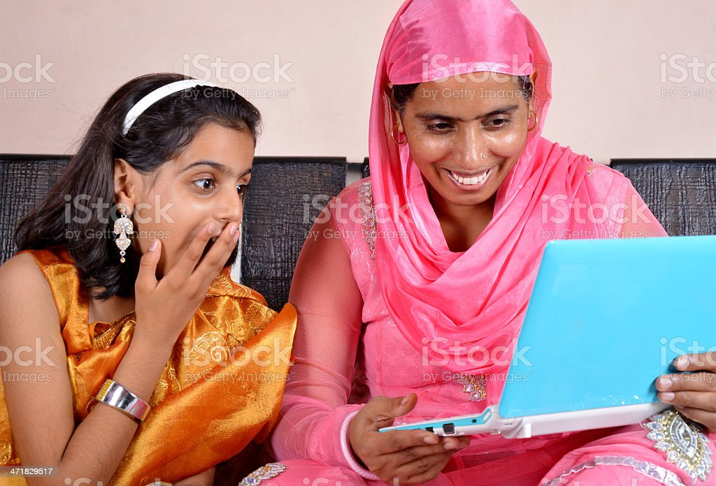 Rural Indian women Holding Laptop with her Little Daughter royalty-free stock photo