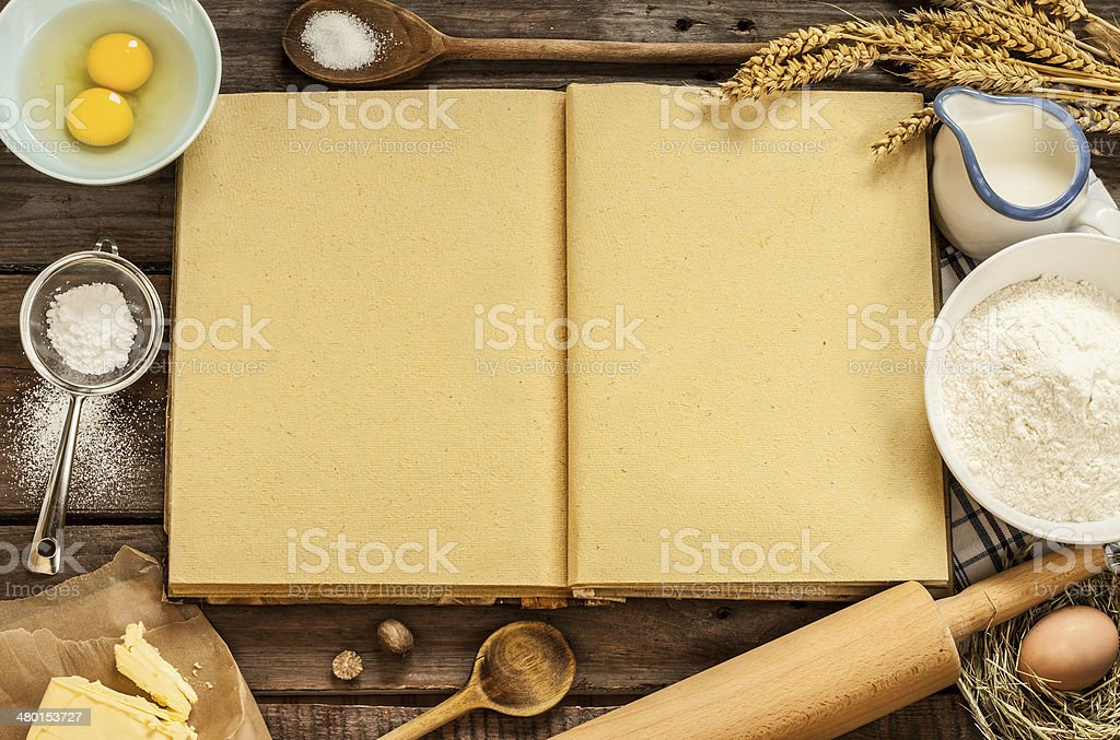Rural kitchen baking cake ingredients and blank cook book stock photo