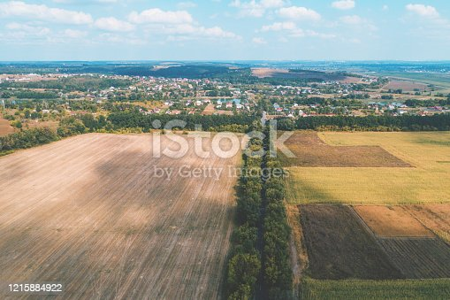 1155573645 istock photo Rural landscape on a summer sunny day. Aerial view 1215884922