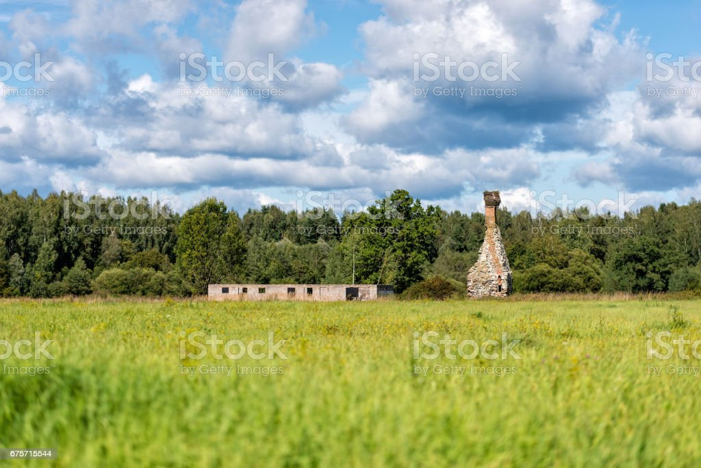 Rural landscape with dilapidated old houses and chimney. royalty-free stock photo