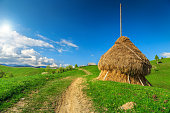 Stunning spring landscape with hay bale and country road,Bran,Transylvania,Romania,Europe