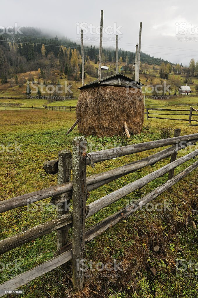 Rural landscape with haystack in autumn mountain village royalty-free stock photo