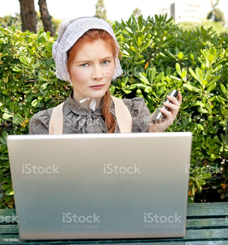 Rural life Amish woman using a laptop for the first time Color Image Stock Photo