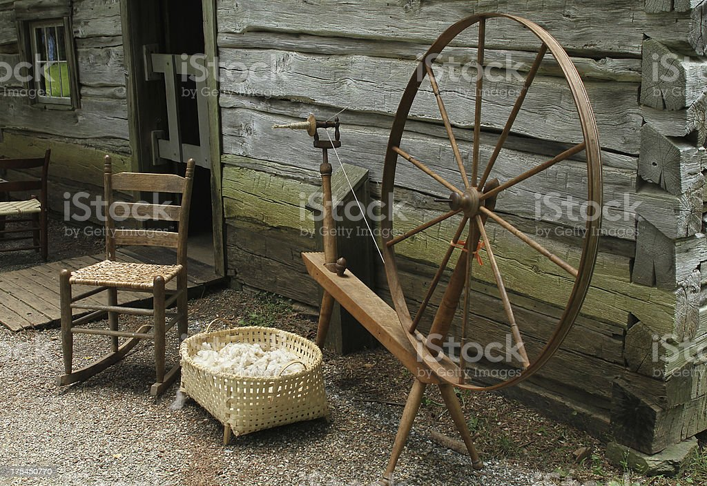 rural lifestyle spinning wheel stock photo