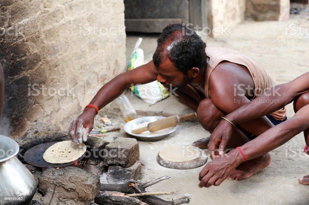Rural men cooking in open  kitchen stock photo