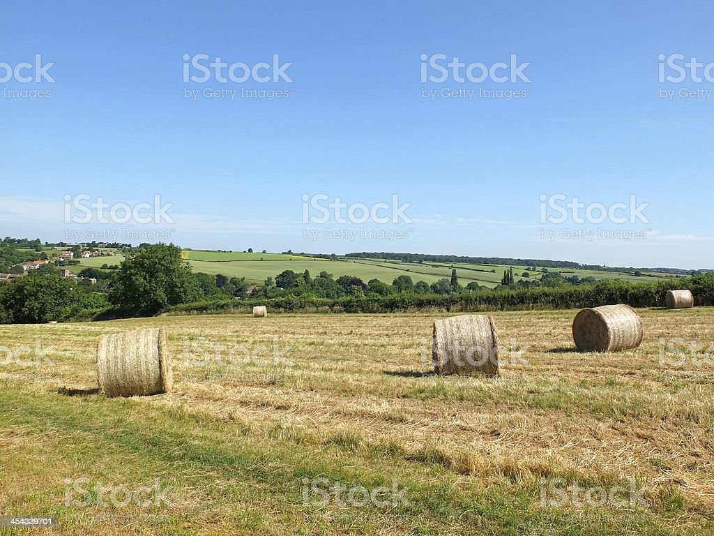 Rural Nottinghamshire field with hay bales and rolling hills landscape. stock photo