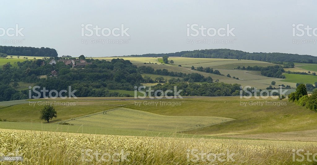 rural panoramic scenery with small village and agriculture royalty free stockfoto