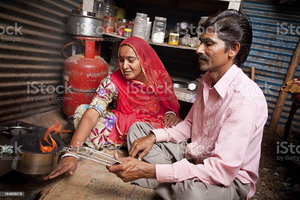 Rural portrait of loving Indian Rajasthani couple in the kitchen royalty-free stock photo