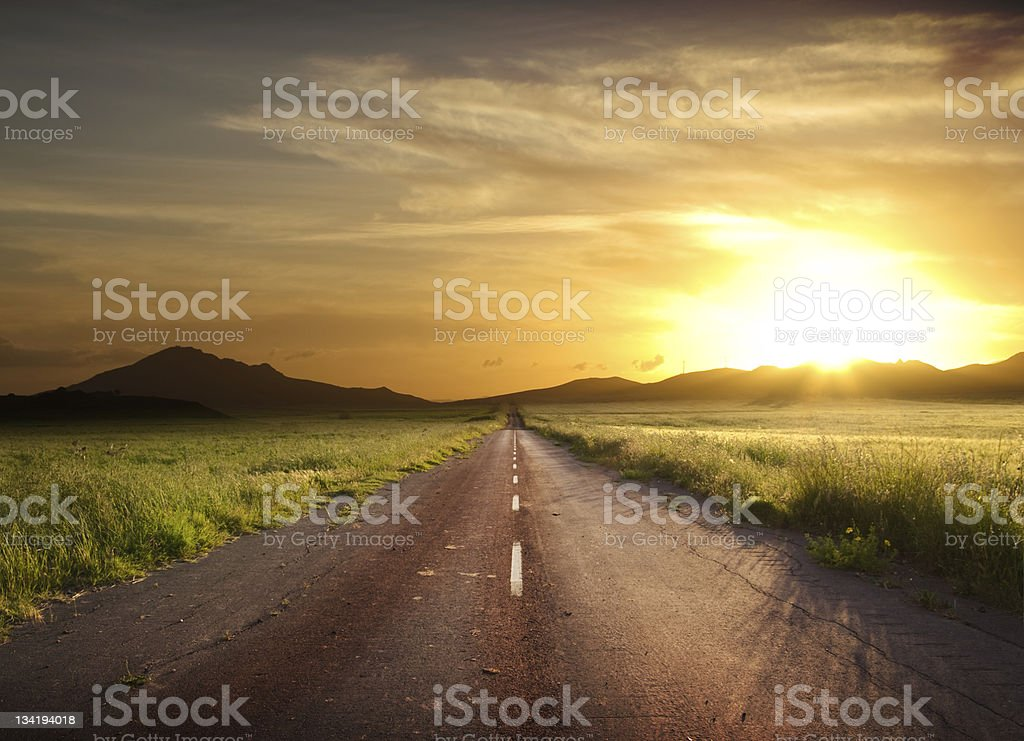 Rural Road Fiery Sunset stock photo