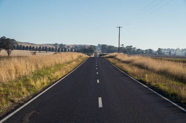 rural road in dookie in the goulburn valley, australia - dotted line stock photos and pictures