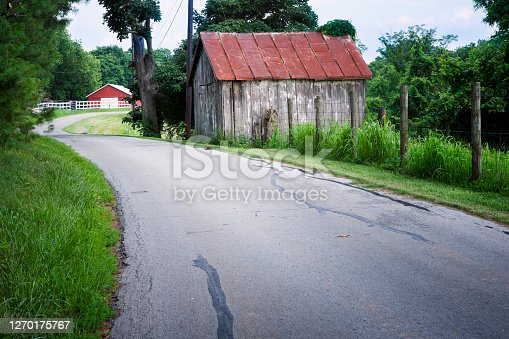 Rural road in Kentucky with two buildings, Kentucky, USA