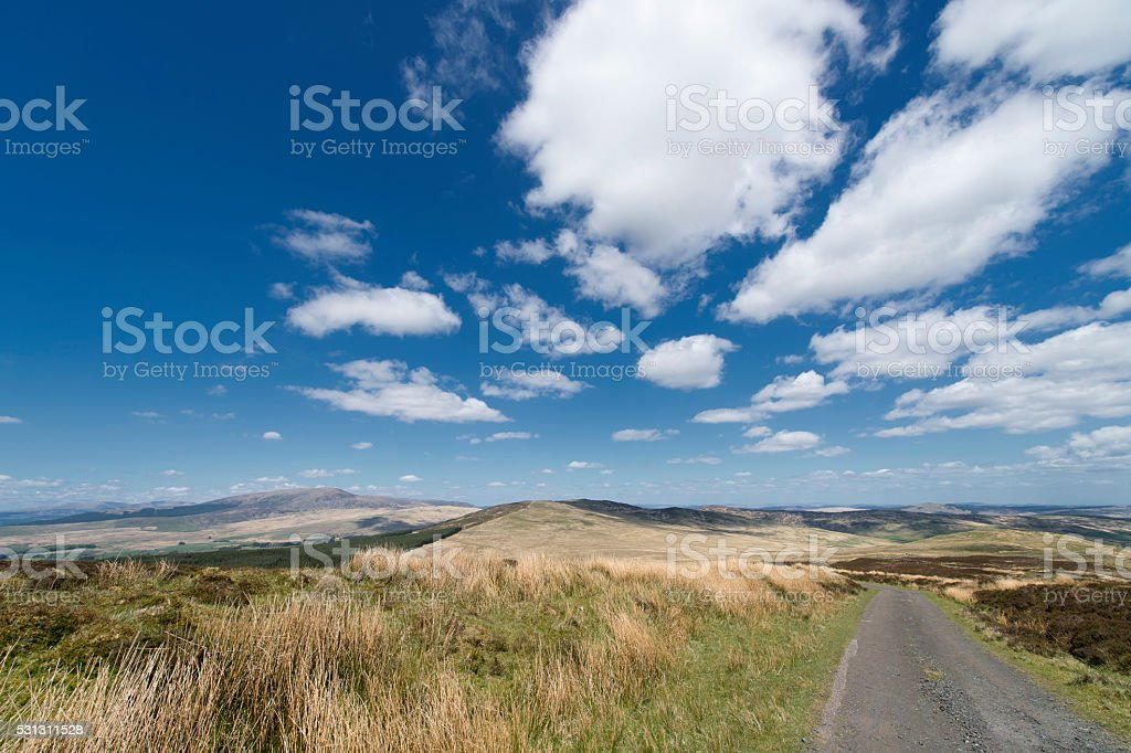 Rural road in remote Scotland on a bright sunny afternoon stock photo