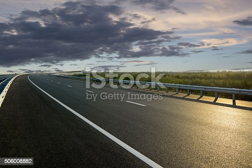 istock Rural road in the sunset 506008882