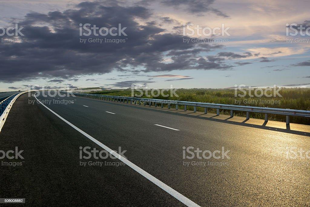 Rural road in the sunset bildbanksfoto