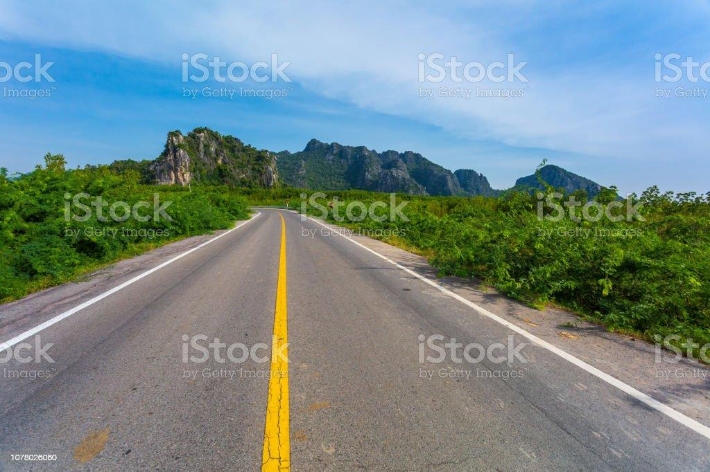 Rural road through stock photo