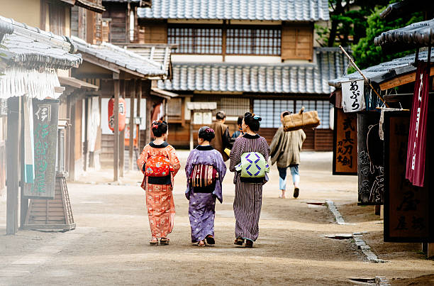rural scene in old japanse village with wooden houses - geisha girl stock photos and pictures