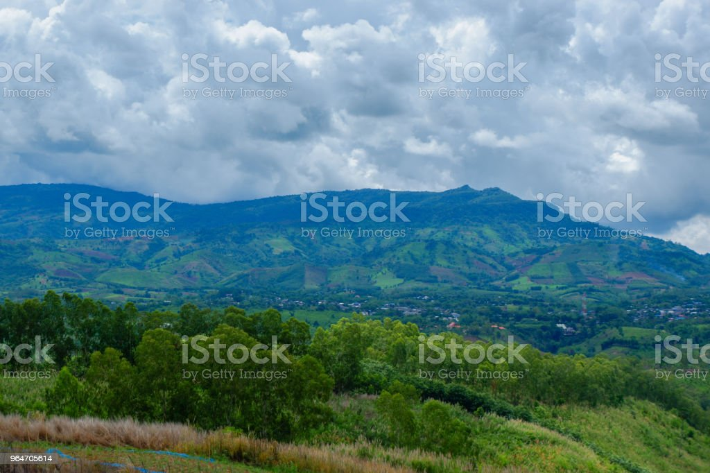Rural scene with mountains in the background royalty-free stock photo