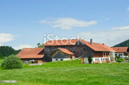 istock rural scenery with beautiful farm house 176861960