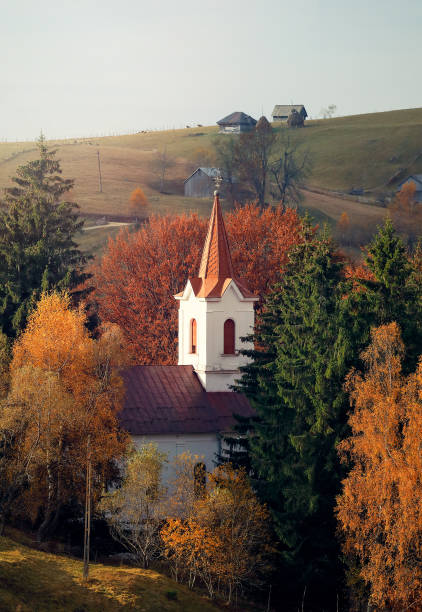 Rural scenery with morning sunlight over the hills and valleys in a Romanian traditional village. Sirnea, between Brasov and Arges county, Romania stock photo