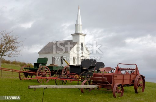Rural Scenic: Classic small town church and old-time farm equipment.