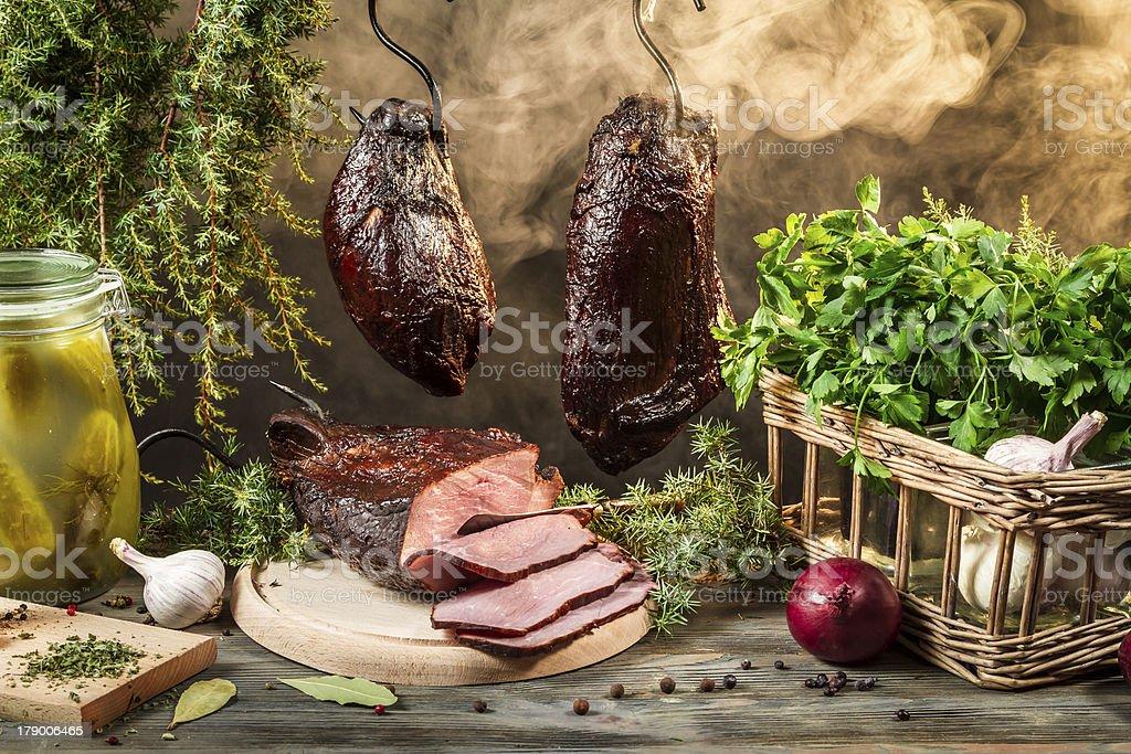 Rural smokehouse ham preparation for smoking royalty-free stock photo