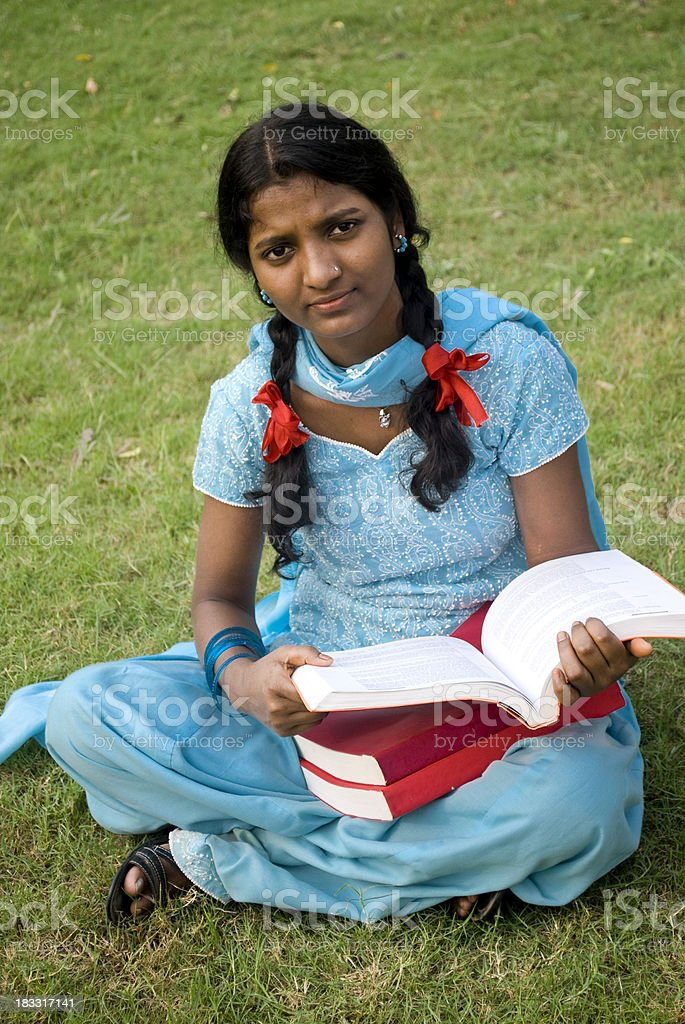 rural student female reading book stock photo