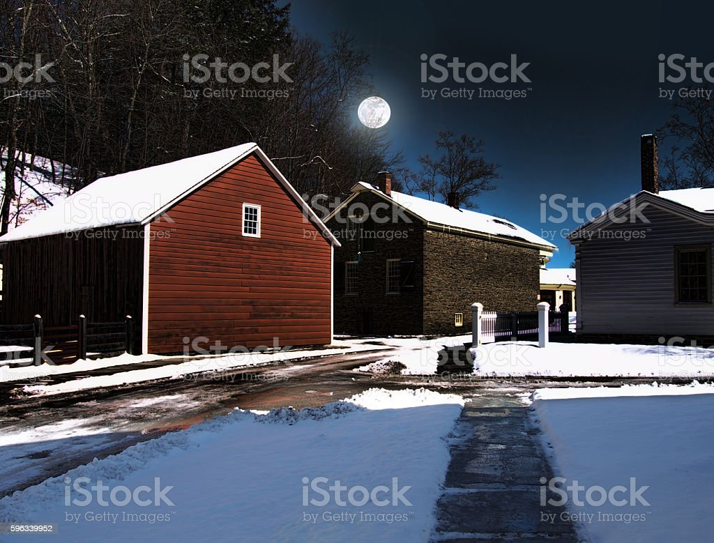 rural village at night in the wintertime royalty-free stock photo