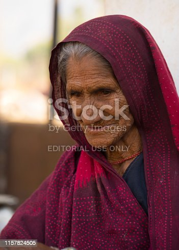 ANDOURE INDIA, DECEMBER 29, 2017 : Rural woman from choudhary community in traditional casual, sitting out her house for look after for children and animal ANDOURE INDIA, DECEMBER 29, 2017