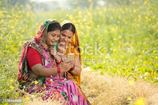 istock Rural women using mobile phone in agricultural field 1126454593