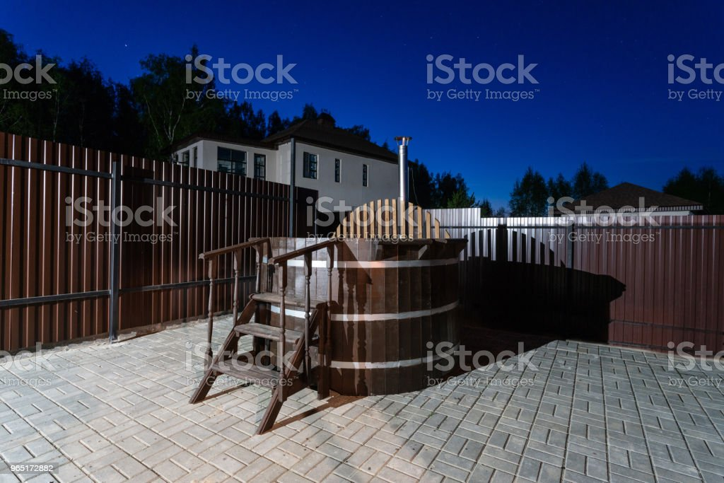 rural wooden water hot tub with stairs garden yard. . night and starry sky royalty-free stock photo
