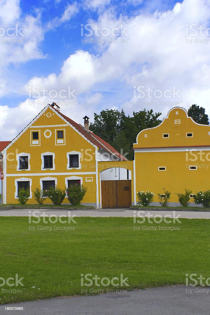 Rural yellow decorated house in Zabori ( Czech Republic) royalty-free stock photo