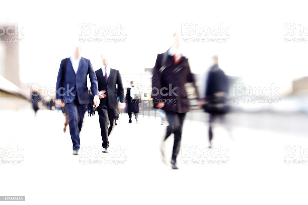 rush hour: abstract high-key business blur of anonymous suited commuters royalty-free stock photo